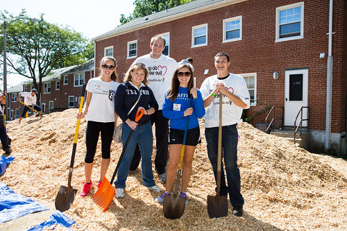 Bentley students help to build a playground